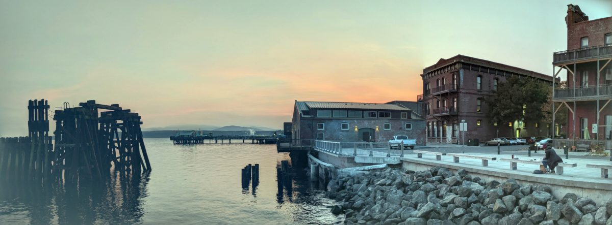 Port Townsend waterfront with sun setting behind